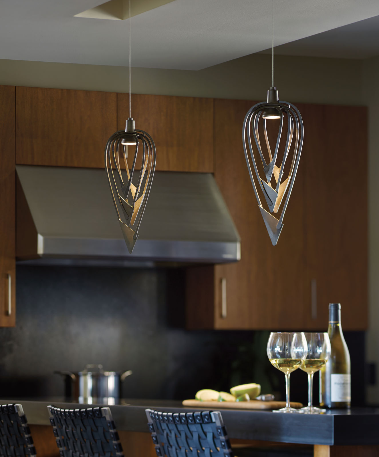 amulet low voltage mini pendant by hubbardton forge over an island in a kitchen - Hubbardton Forge