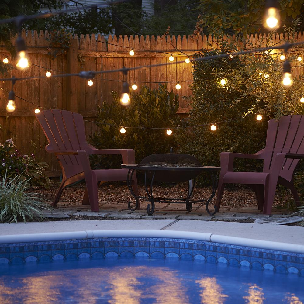 11 Outdoor String Lighting Ideas for a Modern Backyard ... on String Light Ideas Backyard id=79056