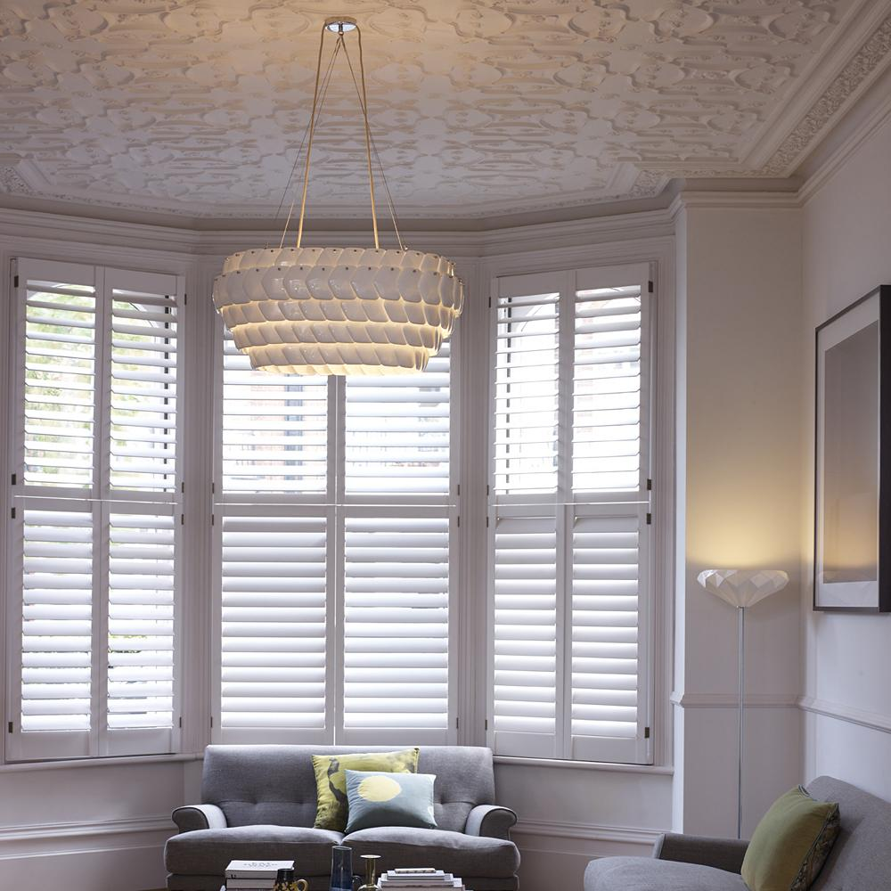 Oval pendant light and matching wall sconce