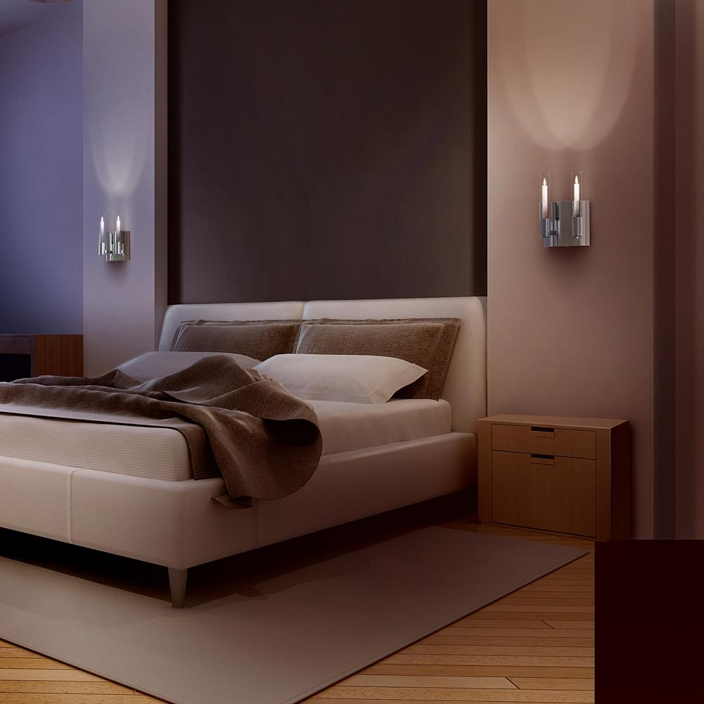 Symmetric wall sconces over bed