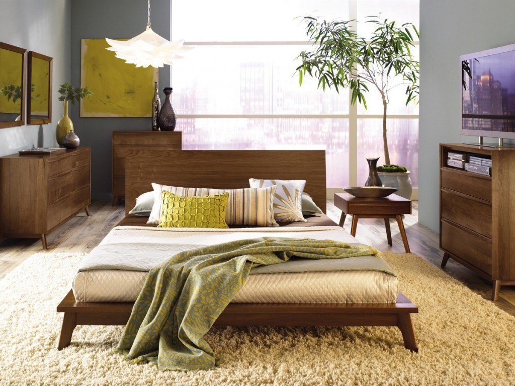 queen beds with organic and geometric pillows.