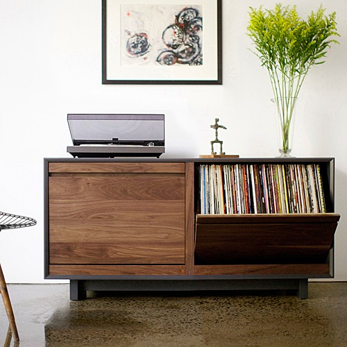 Modern storage cabinet with integrated audio and media systems.