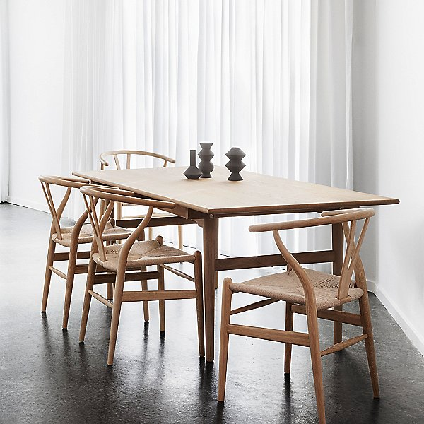 4 wooden wishbone chairs with matching dining table.