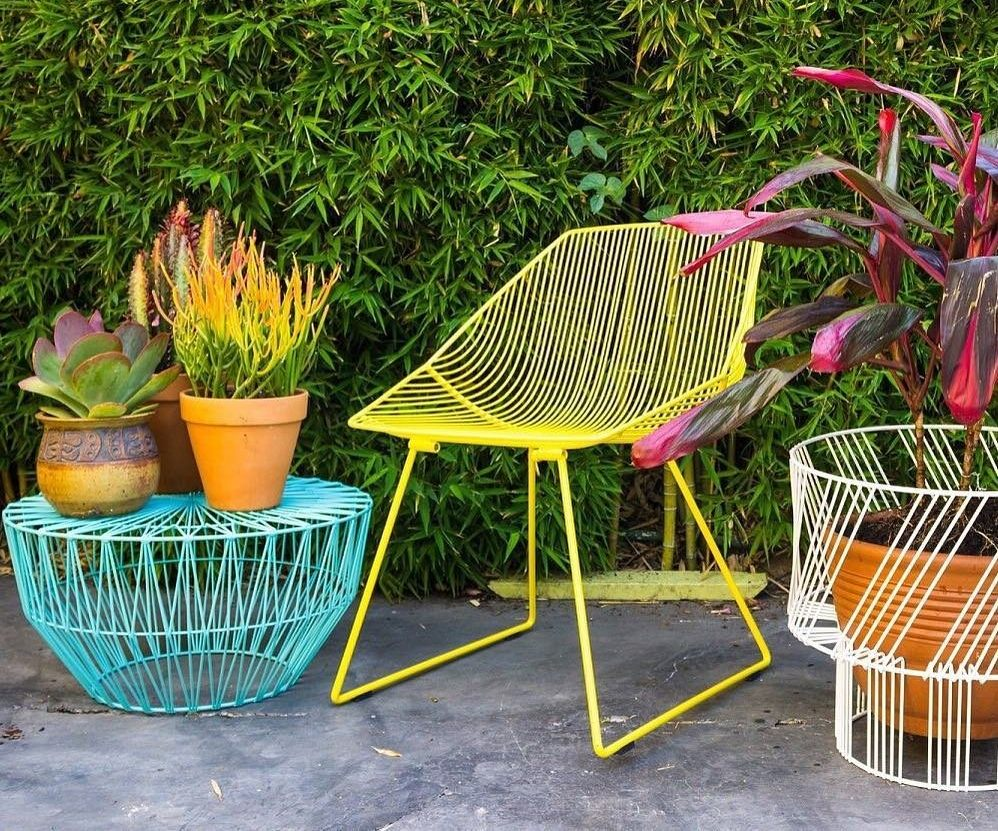 wire frame chair and ottoman in bright color.