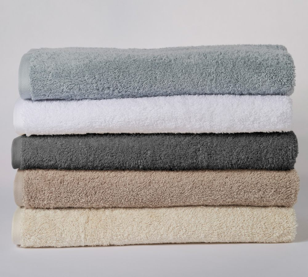 cotton bath rugs in multiple colors.