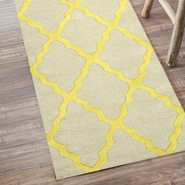 modern hooked rug in yellow.