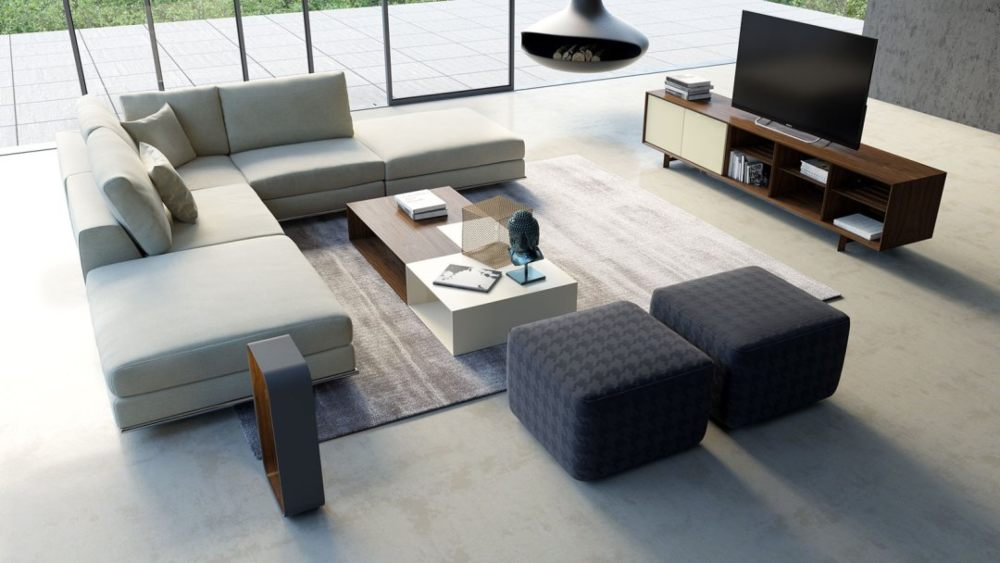 modern living room with sectional, coffee table, media cabinet, ottomans and fans.