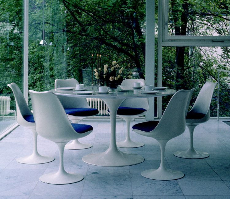 modern blue saarinen chairs and matching dining table.